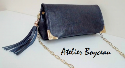Navy blue leather purse with chain