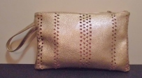 Gold leather hand punched design, pink zip